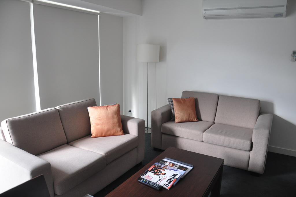 adara-st-kilda-one-bedroom-deluxe-sofa-1