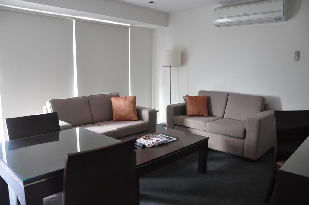 adara-st-kilda-one-bedroom-deluxe-sofa-2